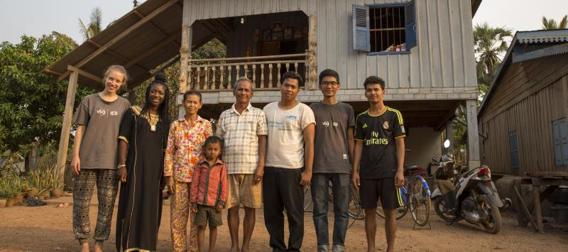 Volunteers with host family in Cambodia