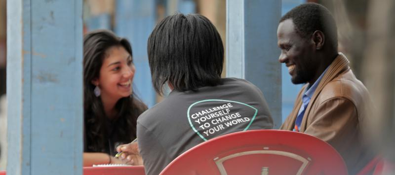 Baloon Ventures volunteers Sarah and Janet talk to entrepreneur Benard from Njoro