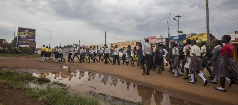 volunteers from Uganda and the United Kingdom join the people of Kayunga to march through Kayunga town