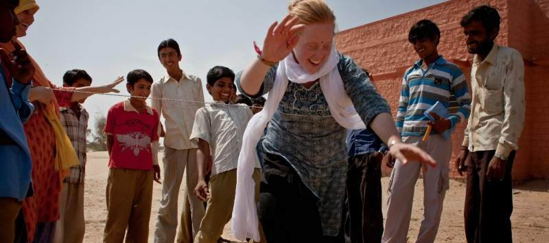 UK volunteer Stephanie Prentice dances with her Indian counterparts